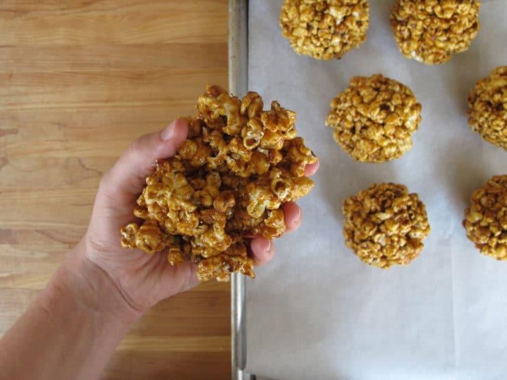Forming popcorn balls.