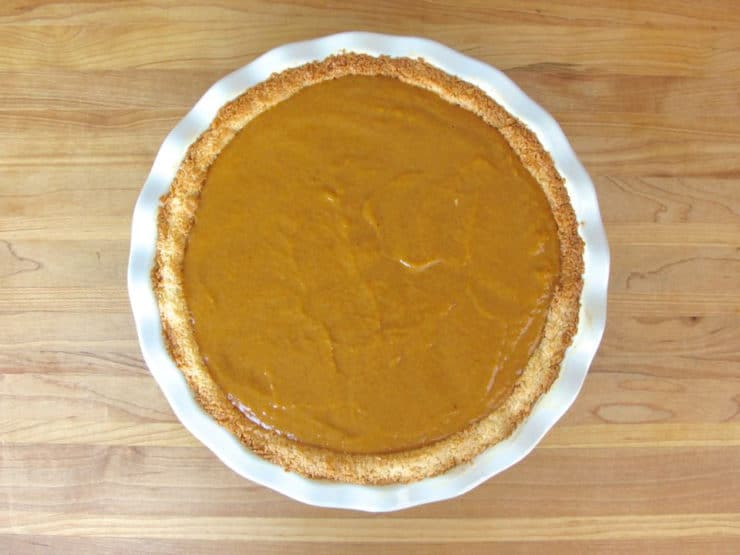 Pour pumpkin filling into baked pie crust.