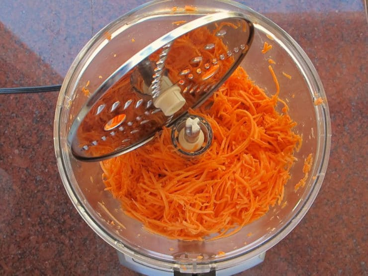 Shredded sweet potatoes in a food processor.