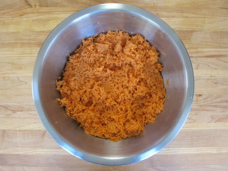 Stir egg and seasonings into shredded sweet potatoes.