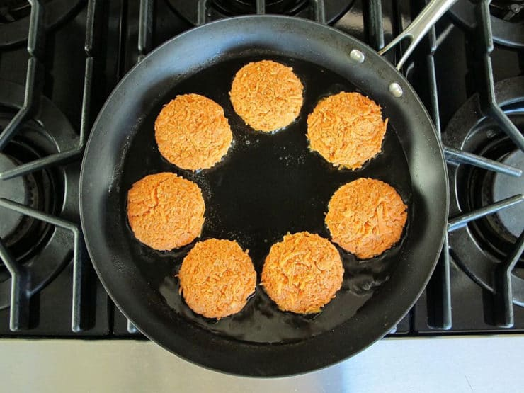 Frying latkes in a skillet.