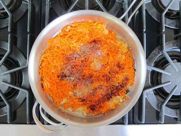 Shredded carrots in a skillet.