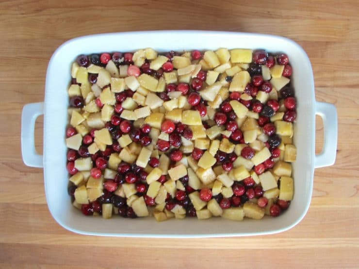 Apple cranberry filling spread in a baking dish.