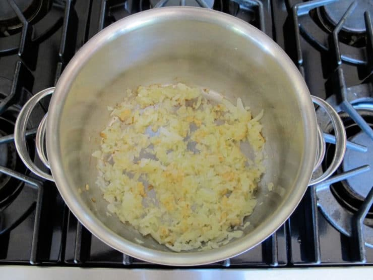Sauteeing onions in a large stockpot.