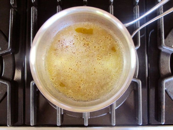 Browning butter in a saucepan.