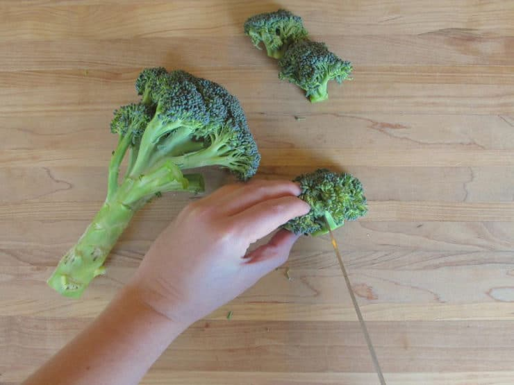 Cutting broccoli into florets.