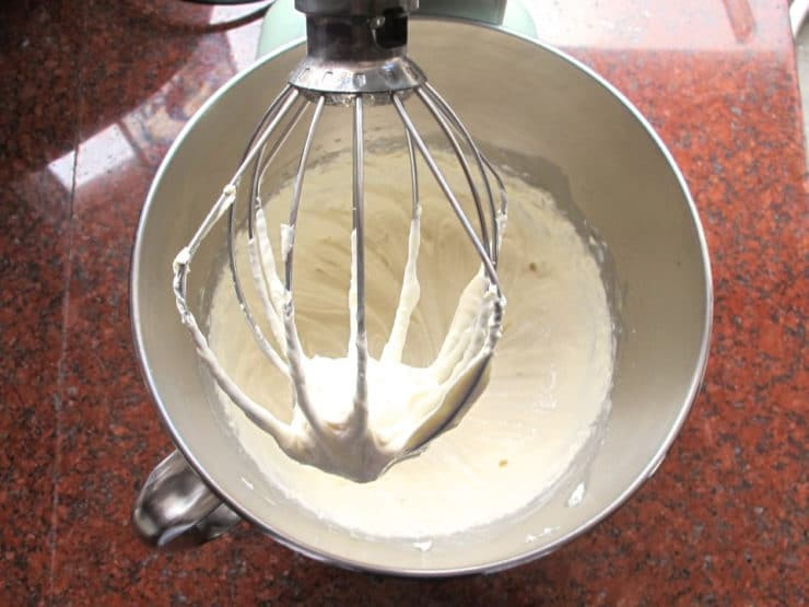 Whipping cream cheese and milk in a stand mixer.