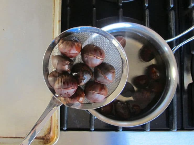 Draining chestnuts.
