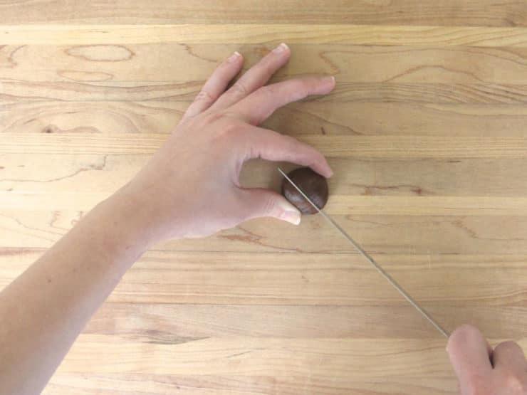 Slicing chestnuts.