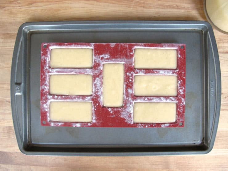 Evenly spread batter into molds.