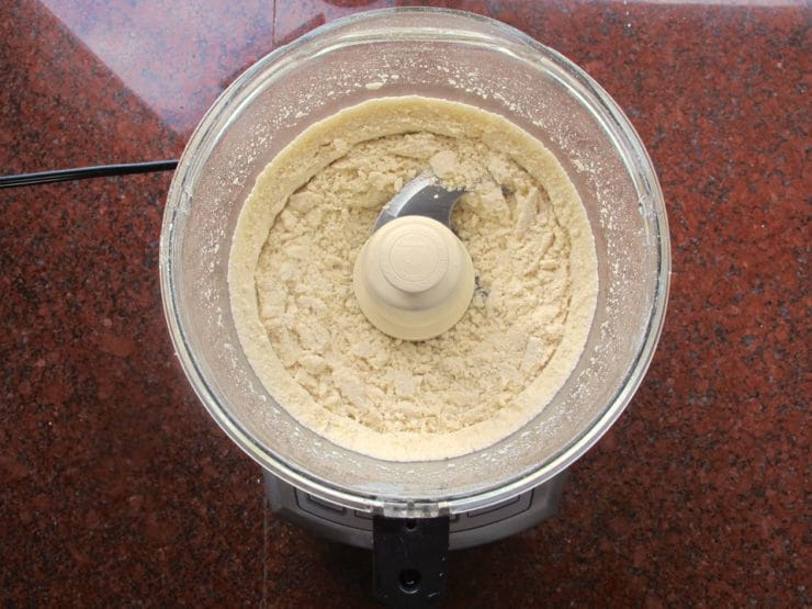 Grinding almonds in a food processor.