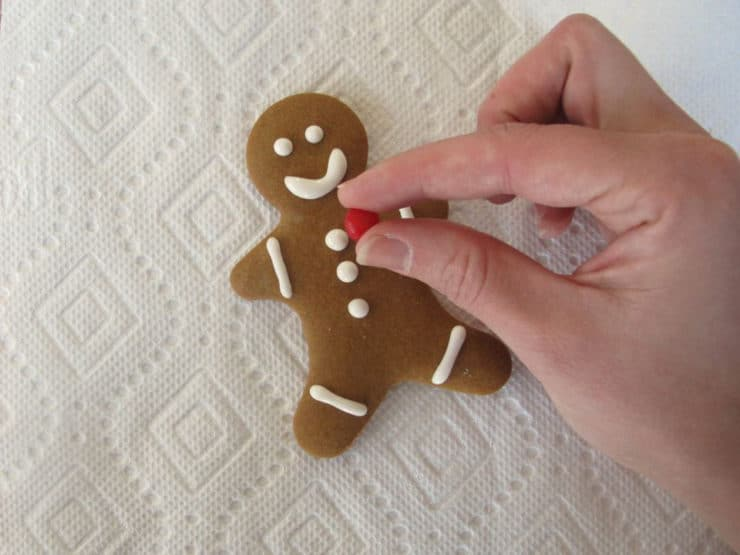 Decorating baked gingerbread men.