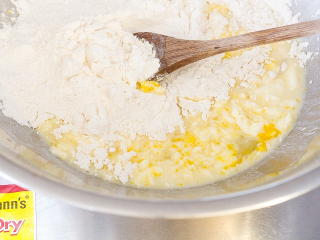 Mixing flour into wet batter.