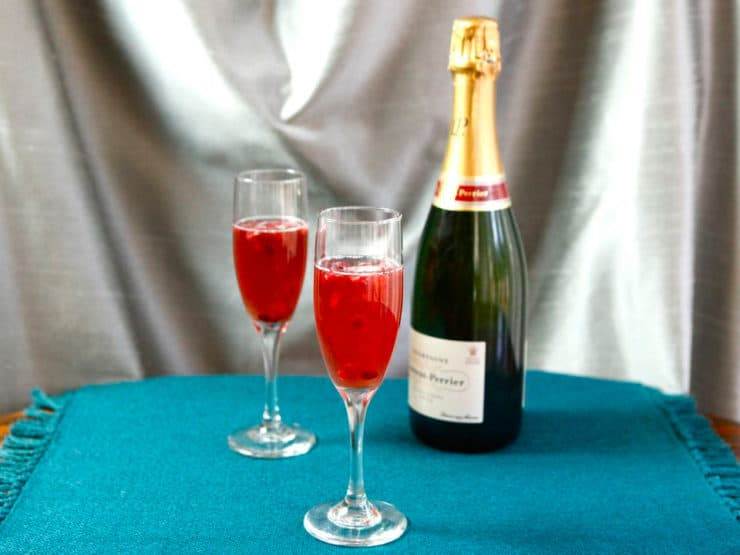 Pomegranate Champagne Cocktail - Delicious champagne cocktail recipe with pure pomegranate juice, orange liqueur, sweet lime juice and champagne. Includes mocktail variation.