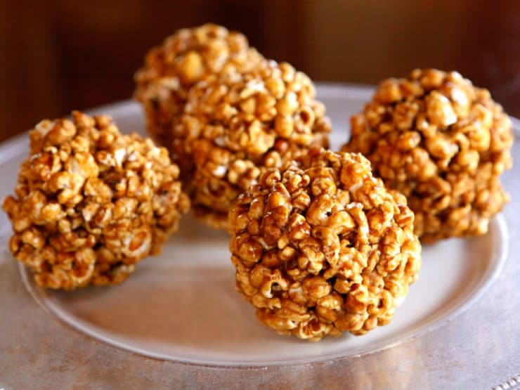 Vintage Popcorn Balls - Learn to make candied popcorn balls the old fashioned way. A vintage treat for Halloween, carnivals, festivals, or just because!