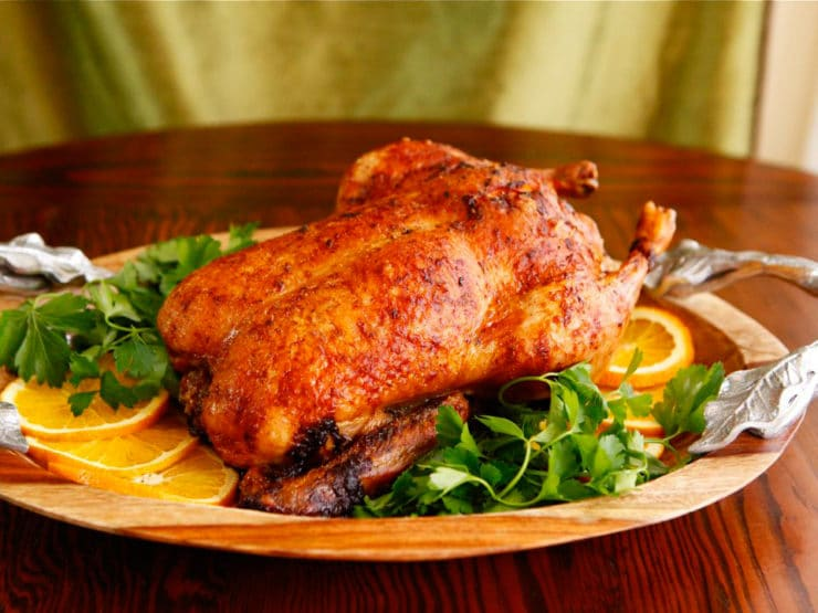 "Roast Duck with Rum - delicious vintage holiday recipe for roast duck with rum, brandy, orange and spices from ""Through Europe with a Jug of Wine"" by Morrison Wood."