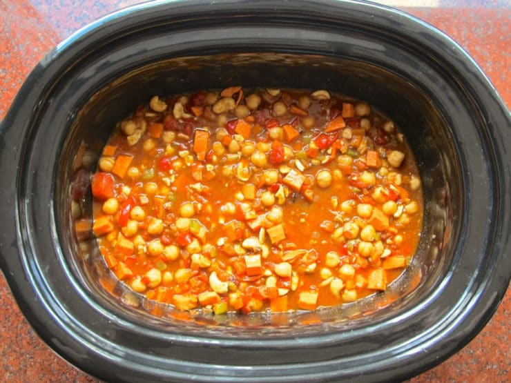 SlowaDiced tomatoes added to slow cooker. Cooker Vegan Chickpea Chili Recipe - Healthy Comfort Food