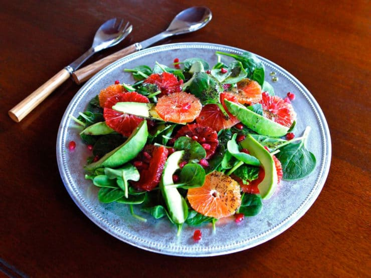 Citrus Avocado Salad with Poppy Seed Dressing - This healthy winter spinach salad recipe with citrus, avocado, pomegranate seeds and poppy seed dressing is nourishing, healthful and seasonal.