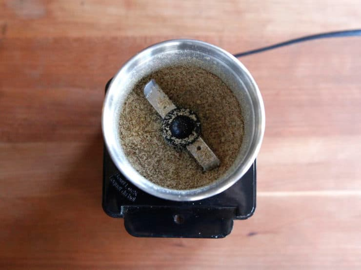 Grinding chia seeds in a spice grinder.
