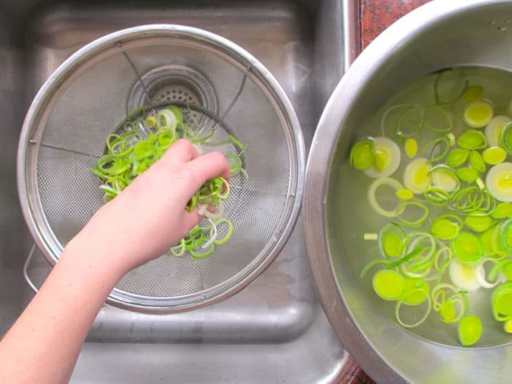 Straining leeks from water.