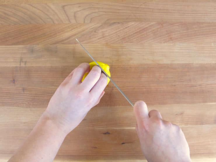 Slicing the ends off lemons.