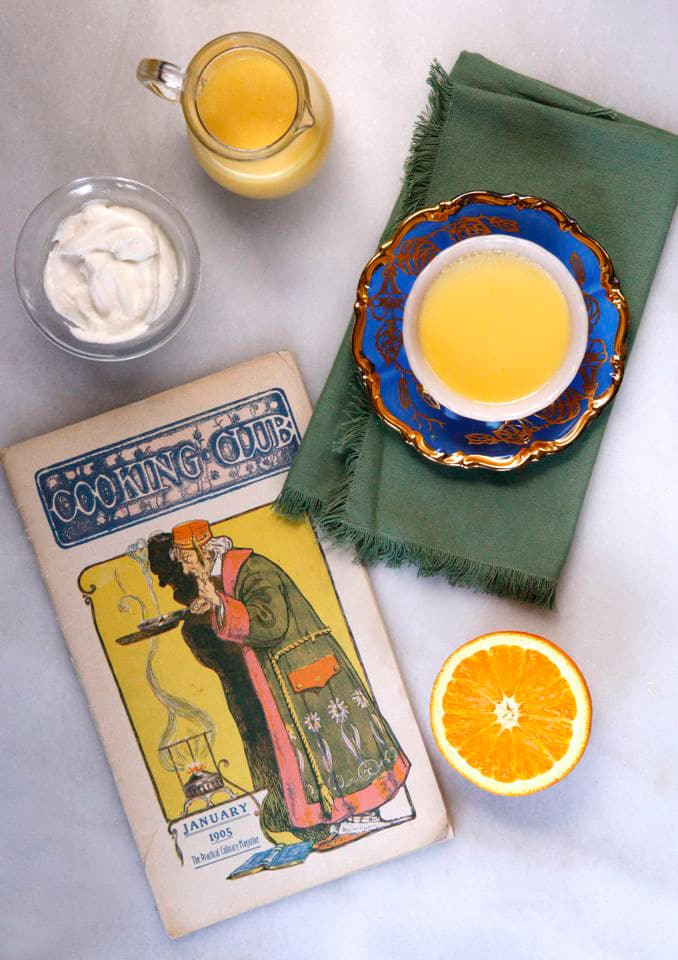 Vintage 1905 recipe for Maple Custard with Orange Sauce, adapted by Tori Avey from Cooking Club Magazine on The History Kitchen