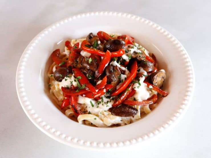 Mushroom Pepper Pasta with Feta Goat Cheese Sauce - Recipe for fettuccine pasta tossed with a creamy feta goat cheese sauce, topped with seared mushrooms and bell peppers. Flavorful, easy weeknight meal.