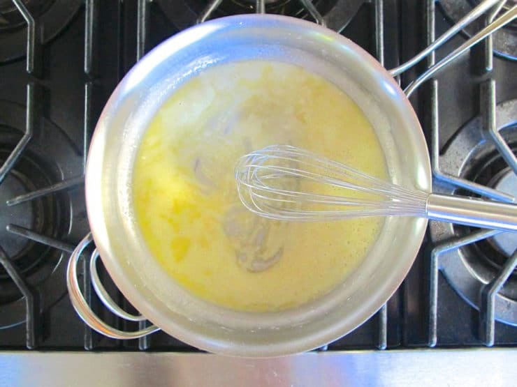 Whisking cornstarch into melted butter.
