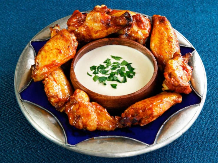 Spicy Middle Eastern Chicken Wings with Creamy Tahini Sauce - Baked, not fried. Lightened up, flavorful alternative to buffalo wings.