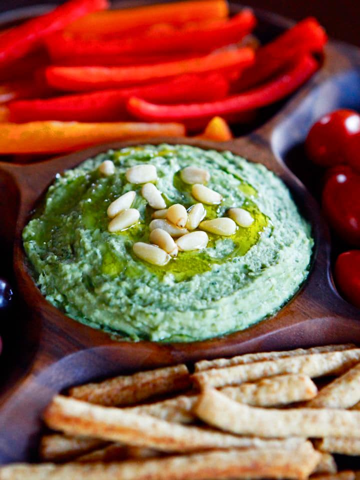 White Bean Basil Pesto Hummus - Simple recipe for white bean hummus with fresh basil, roasted garlic, olive oil and fresh lemon juice. Healthy, tasty Mediterranean dip.