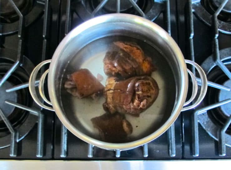 Ham hocks in boiling water.