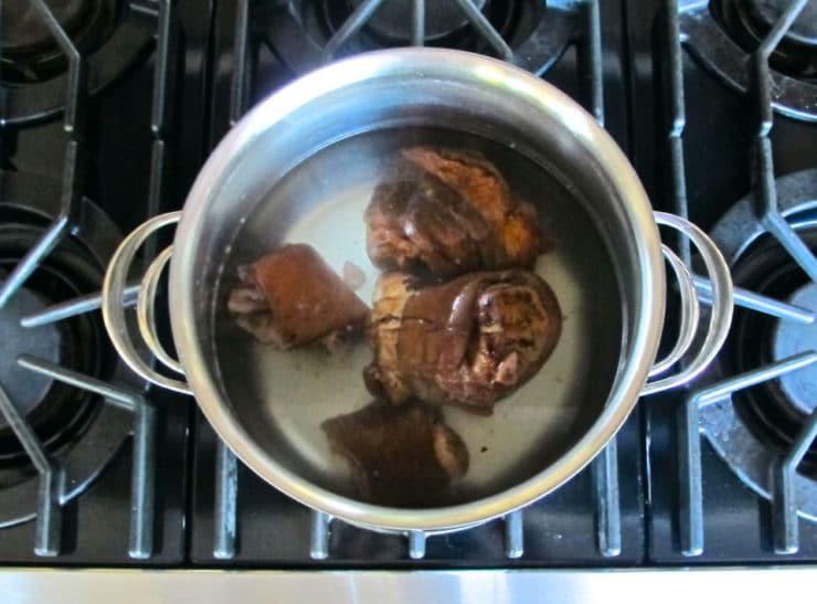 Ham hocks in boiling water.