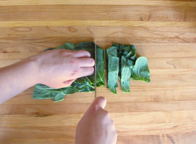 Slicing raw greens.