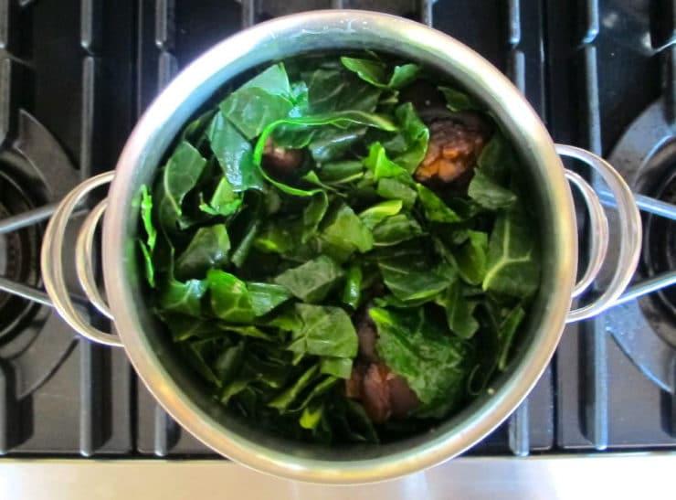 Collard greens simmering in water.