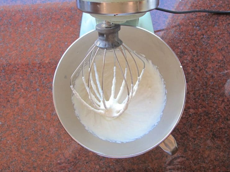 Whipping ricotta in a mixer.