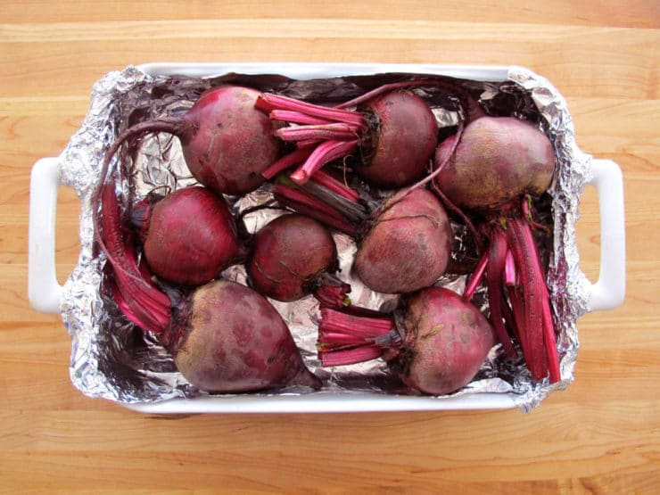 Beets in a foil lined pan to roast.