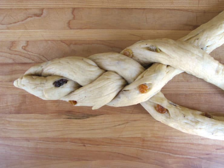 Braiding three strands of bread dough.