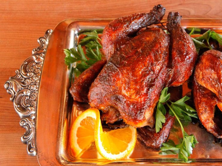 Marinated Cornish Game Hens with Citrus and Spice - Cornish game hens marinated with orange juice and spices for an aromatic and impressive entree. Lightly sweet, spiced with a hint of citrus.