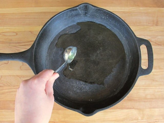 How to Clean and Season a Cast Iron Pan - Step By Step Tutorial for Extending the Life of   your Cast Iron Cookware by Tori Avey