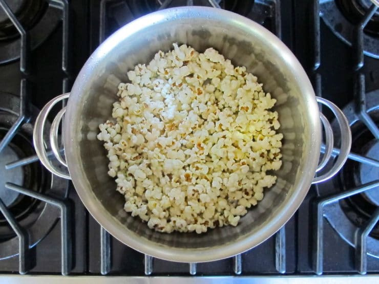 Popped popcorn in a deep pot.