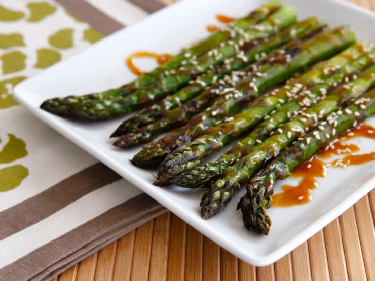 Roasted Sesame Asparagus - Roasted asparagus drizzled with a sesame-flavored sweet and spicy sauce and sprinkled with sesame seeds. Kosher, pareve, healthy, simple recipe.