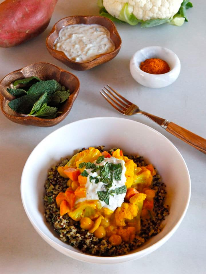 Vegetable Curry Quinoa Bowl - Recipe for creamy Indian-Style curry with cauliflower, sweet potato and chickpeas, over mint and parsley quinoa. Vegan or Vegetarian.