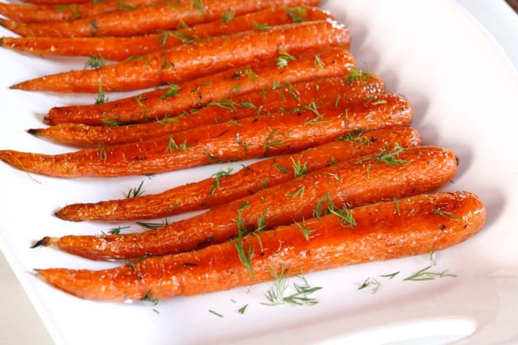 Roasted Carrots with Dill - Roasted whole carrots with olive oil, kosher salt, pepper and fresh dill. Who knew something so simple could taste so amazing?