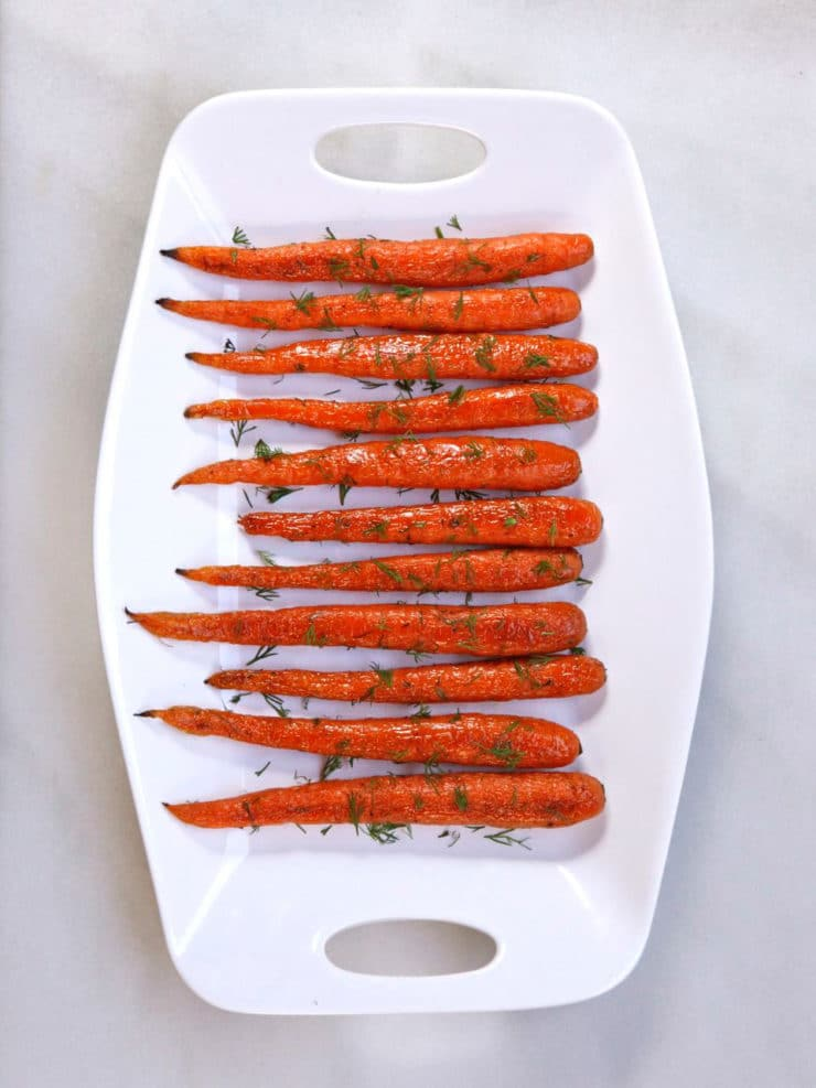 Roasted Carrots with Dill - Roasted whole carrots with olive oil, kosher salt, pepper and fresh dill. Simple springtime side dish. Who knew something so simple could taste so amazing?