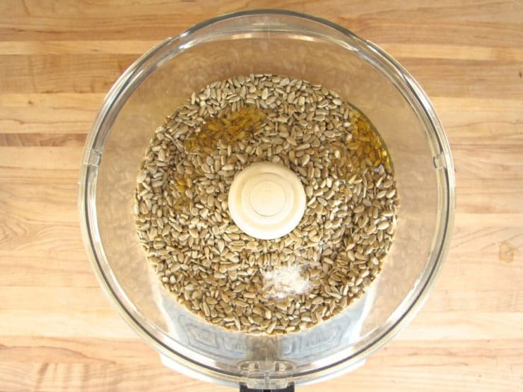 Toasted sunflower seeds in a food processor.