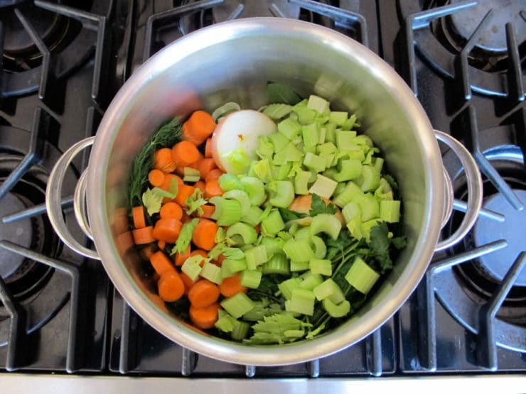 Diced vegetables in a stockpot.