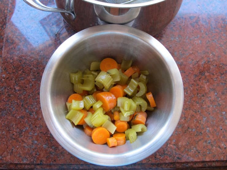 Cooked, diced vegetables in a bowl.