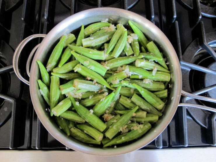 Okra added to saute pan with onions.