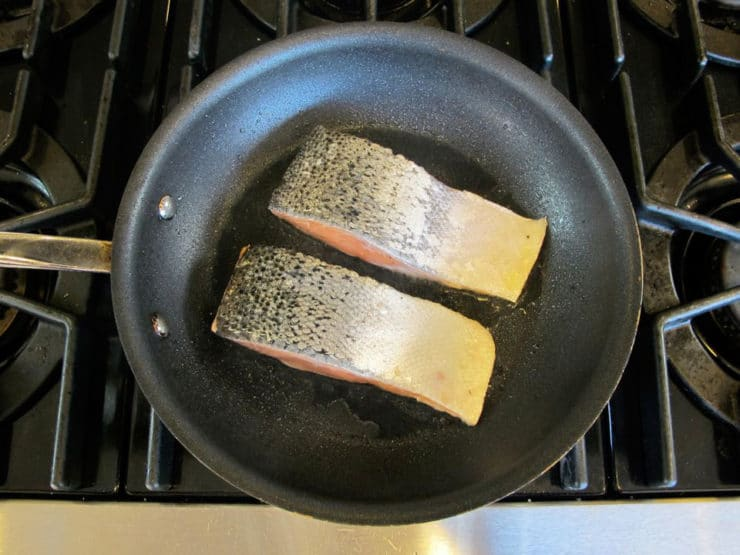 Searing salmon, flesh side down.