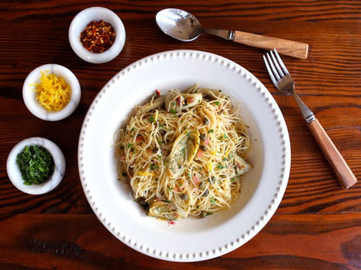 Lemon Butter Pasta with Artichokes and Capers - A delicious spring-inspired, easy and flavorful recipe for meatless meal by Tori Avey.